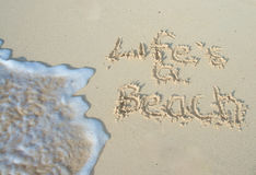 Life's a beach. Written in the sand Stock Photo