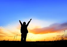 Life's enjoyment. A female traveler in sunset Stock Photos
