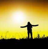 Life's enjoyment. Silhouette on gradient background Stock Photo