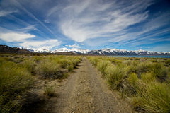 Life's Uncertain Track. A striaght path cuts through the wilderness of eastern California beside Mono Lake toward Yosemite National Park Royalty Free Stock Image