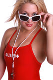 Life saver. A pretty young blond woman wearing a life guard swimsuit and a whistle stock images