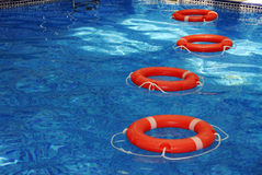 Life saver. A view of bright orange life savers at the pool Stock Images