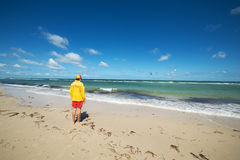 Life saver. Young man life saver watching the situation on the sea.Wide angle royalty free stock images