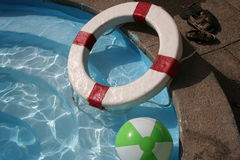 Life saver and ball. A day in the pool Royalty Free Stock Photography