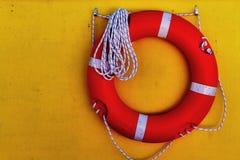 Life saver buoy hanging in a yellow wall. Of seaship. Greece, Corfu royalty free stock photos