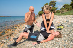 Life saver. CPR training on a scuba diver on a beach royalty free stock images