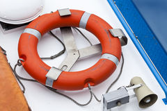 Life saver and horn on ship's deck Stock Image