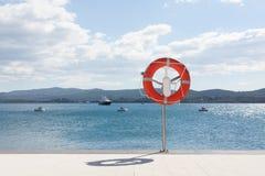 Life saving belt at marina Royalty Free Stock Photos