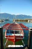 Life saving boat at Geneva lake, Town of La Tour-de-Peilz, S. Red life saving boat at Geneva lake, Town of La Tour-de-Peilz, Switzerland stock images