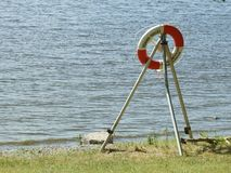 Life saving buoy by the edge of the water. Life saving buoy by the water royalty free stock image