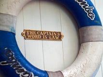 Life saving buoy on wooden wall stock photo