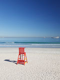 Life saving chair. And ships at the beach, Cape Town royalty free stock image