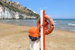 Life saving equipment. Gargano National Park in Italy - Pizzomunno Beach in Vieste. Life buoy equipment stock photos