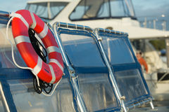 Life-saving preserver at a marina. Taken in Souther Florida, a yacht has a flotation device royalty free stock photo