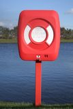 Life Saving Ring. By lake side for rescuing swimmers or people who are in trouble stock image