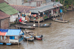 Daily life scene of the floating village at Mekong Delta Stock Photography