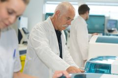 Life scientist researching in laboratory. Senior Stock Photo