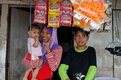 Life in Semporna. SABAH, MALAYSIA - 19TH SEPTEMBER 2013; Daily life at Semporna jetty in Sabah. Unidentified lady with her siblings sell a packets food to local Royalty Free Stock Photo