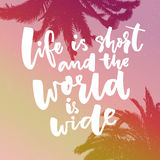 Life is short and the world is wide. Inspiration saying about travel at pink gradient background with palms Royalty Free Stock Image