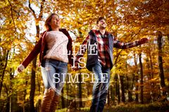 Life is simple-happy couple running through park royalty free stock photos