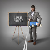 Life is simple text on blackboard with businessman Stock Image