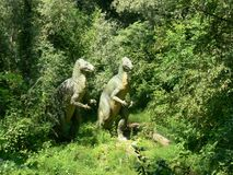 Two carnivore dinosaurs in the wood of the Extinction Park in Italy Stock Images