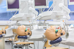 Life-sized manikins forgiving human errors. Shot of manikins in a dentistry educational laboratory Royalty Free Stock Image