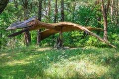 Quetzalcoatlus dinosaur statue. Life sized Raptor Quetzalcoatlus dinosaur statue in a forest Stock Photography
