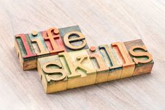 Life skills typography in wood type. Life skills - word abstract in letterpress wood type printing blocks Royalty Free Stock Photos