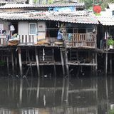 Life in the slums of Bangkok,Thailand. House build beside the Canal with dirty water. pollution problem Royalty Free Stock Photos