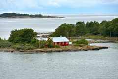 Life on small islands. Red wooden house. Aland Islands, Finland Royalty Free Stock Photos