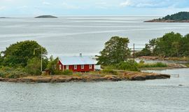 Life on small islands. Red wooden house. Aland Islands, Finland Stock Photos