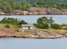 Life on small islands. Traditional Scandinavian white wooden house. Aland Islands, Finland Stock Image