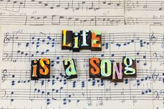 Life song sing live love happy feel alive letterpress type stock photo
