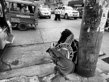 Life in the streets. The man in the picture is taking a rest after working hard Stock Images