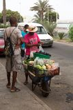 Life on the streets of Mindelo.Street vendor of vegetables Stock Image