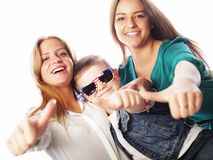Life style, happiness, emotional and people concept: brother ans two sisters. Showing ok stock photos