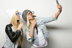 Life style, happiness, emotional and people concept: two hipster. Girls taking photo. Happy selfie stock photo