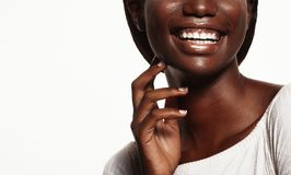 Close up portrait of beautiful young black woman laughing. Life style and people concept: Close up portrait of beautiful young black woman laughing Royalty Free Stock Photography