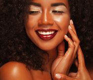 Close up portrait of beautiful young black woman laughing. Life style and people concept: Close up portrait of beautiful young black woman laughing Stock Image