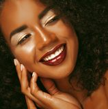 Close up portrait of beautiful young black woman laughing. Life style and people concept: Close up portrait of beautiful young black woman laughing Royalty Free Stock Photo