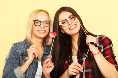 Life style and people concept: stylish girls   ready for party. Life style and people concept: stylish girls best friends ready for party Royalty Free Stock Images