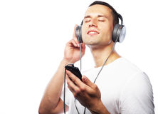 Life style and people concept:Young man enjoying music on his he Stock Photo