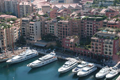 Life styles. Yachts in Monte Carlo with a view of surrounding city Stock Photo