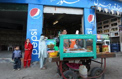 Daily life in Swat Valley, Pakistan. Islamabad, Pakistan. 27 October 2011. Food seller waiting for costumer at their stall in Mingora the main town of Pakistan's Royalty Free Stock Photo