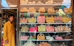Life in Swat Valley, Pakistan. Pastry shop display window with variety of cookies and cakes in Mingora, the main town of Swat Valley, Northern Pakistan Stock Photography