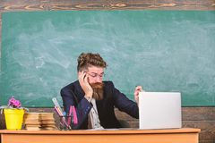 Life of teacher full of stress. Educators more stressed at work than average people. Educator bearded man sleepy face. Tired work laptop. High level fatigue stock photography