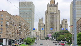 Daily life and traffic in Moscow. View with one of seven sisters Stalinist style skyscraper building, constructed during Stalin era in central Moscow, Russia stock video