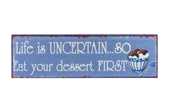 Life is Uncertain. Quote Goes Life is Uncertain so Eat Your Dessert First on a Metal Plate Isolated on a White Background Stock Photo