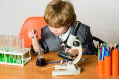 Life under microscope. science experiments with microscope in lab. school kid scientist studying science. Little boy is royalty free stock image